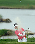 SUZHOU, CHINA - APRIL 18:  Y.E. Yang of Korea plays a bunker shot on the 1st hole during the Round Four of the Volvo China Open on April 18, 2010 in Suzhou, China. Photo by Victor Fraile / The Power of Sport Images