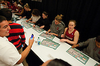DENVER, CO--Lindy LaRocque signs posters with her teammates during a fan autograph session at the Pepsi Center for the 2012 NCAA Women's Final Four festivities in Denver, CO.