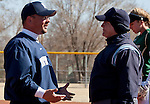 March 7, 2012:   Nevada Wolf Pack head coach Matt Meuchel discusses a call with the first base umpire during their NCAA softball game against the Sacramento State Hornets played at Christina M. Hixson Softball Park on Wednesday in Reno, Nevada.