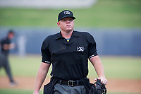 Minor League Baseball Umpire Ray Patchen handles the calls behind the plate during a game between the AZL Brewers and the AZL Padres 2 on September 2, 2017 at Maryvale Baseball Park in Phoenix, Arizona. AZL Brewers defeated the AZL Padres 2 2-0. (Zachary Lucy/Four Seam Images)