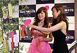 July 1, 2016, Tokyo, Japan - Japanese violinist Junko Makiyama and pianist Riyoko Takagi put paper slips with their wishes on the branches of a bamboo three for the Tanabata or star festival at an interval of their jazz session at the Mitsukoshi department store in Tokyo's Ginza district on Friday, July 1, 2016. Their public recording of FM broadcasting will be on air on July 24.  (Photo by Yoshio Tsunoda/AFLO) LWX -ytd-