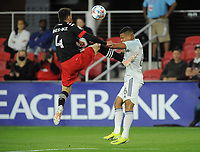 WASHINGTON, DC - MAY 13: Brendan Hines Ike #4 of D.C. United battles for the ball with Miguel Angel Navarro #6 of Chicago Fire FC during a game between Chicago Fire FC and D.C. United at Audi FIeld on May 13, 2021 in Washington, DC.
