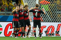 Andre Schurrle of Germany celebrates scoring a goal after making it 0-6