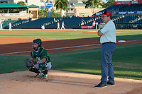Daytona Tortugas catcher Mark Kolozsvary (2) catches a bullpen as Hall of Fame Catcher Johnny Bench looks on before a Florida State League game against the Palm Beach Cardinals on April 11, 2019 at Roger Dean Stadium in Jupiter, Florida.  Palm Beach defeated Daytona 6-0.  (Mike Janes/Four Seam Images)