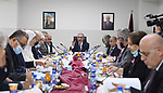 Palestinian Prime Minister Mohammed Ishtayeh chairs the weekly meeting of his government, in the West Bank city of Jenin on October 11, 2021. Photo by Prime Minister Office