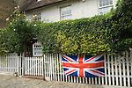 Bunting Union Jack Flag om cottage fence. Upnor a Medway village in Kent UK.