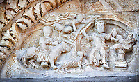 Lunette of the main portal with Romanesque sculptures of Abraham about to sleigh Isaac , Basilica Church of Santa Maria Maggiore, Tuscania