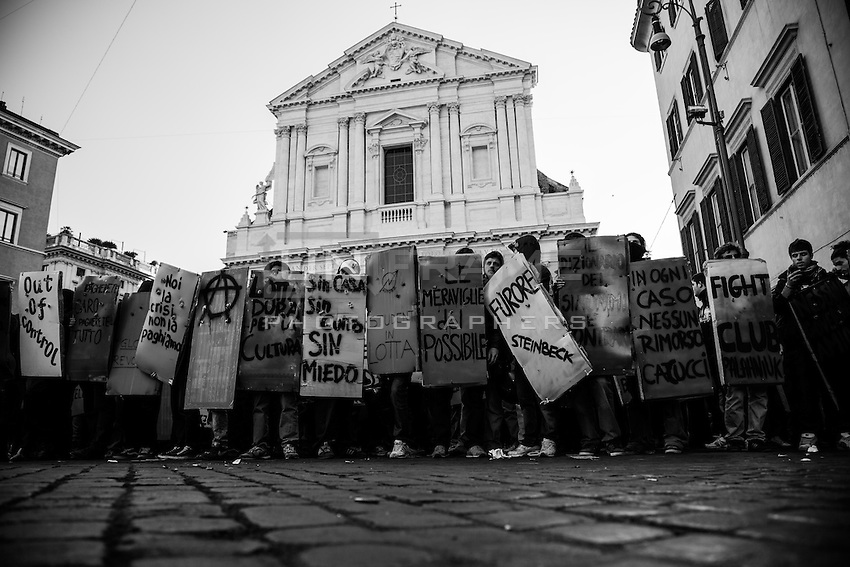 """""""book blocs"""" in front of Sant'Andrea della Valle church show their shields in form of classic books.<br /> Student groups (book blocs) and labor unions (Cobas) protested against the new government just formed and headed by the new prime minister Mario Monti. Rome, Italy.  17 november 2011"""