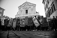 """book blocs"" in front of Sant'Andrea della Valle church show their shields in form of classic books.<br /> Student groups (book blocs) and labor unions (Cobas) protested against the new government just formed and headed by the new prime minister Mario Monti. Rome, Italy.  17 november 2011"