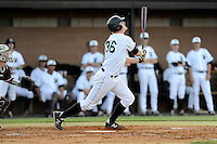 First baseman Charlie Carpenter (36) of the University of South Carolina Upstate Spartans bats in a game against the College of Charleston Cougars on Tuesday, March 31, 2015, at Cleveland S. Harley Park in Spartanburg, South Carolina. Charleston won, 10-0. (Tom Priddy/Four Seam Images)