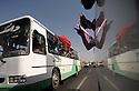 Iraq 2009  .Iraqi supporters of the PKK in a bus on the way to the Turkish border with flags to wave fighters of PKK crossing the border .Irak 2009.Sympathisants du PKK dans un autobus les menant a la frontiere, venus pour saluer des combattants du PKK qui vont traverser la frontiere..