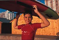 Robert with his surfboard. Durban Beach, KwaZulu-Natal, South Africa