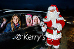 Siadhbh, Siun and Aoibhinn O'Donnell delighted with their drive by as the meet Santa in Spa on Saturday.