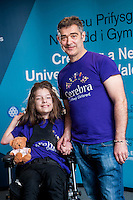 COPY BY TOM BEDFORD<br /> Sunday 26 June 2016<br /> Pictured: Poppy and Dad Rob<br /> Re: A very special father-and-daughter team have tackled the Cardiff Triathlon.<br /> Poppy Jones, 11, who will be competing alongside dad Rob Jones, wants to win the event.<br /> And she's not going to let the fact that she has quadriplegic cerebral palsy , which means she can't sit, stand, roll or support herself, and chronic lung disease stop her.<br /> She will be by Rob's side every step of the way thanks to a cutting-edge wheelchair and boat – for Rob to push or pull – designed especially for the event, which sees participants take part in a swim across Cardiff Bay , a run and a bike ride.