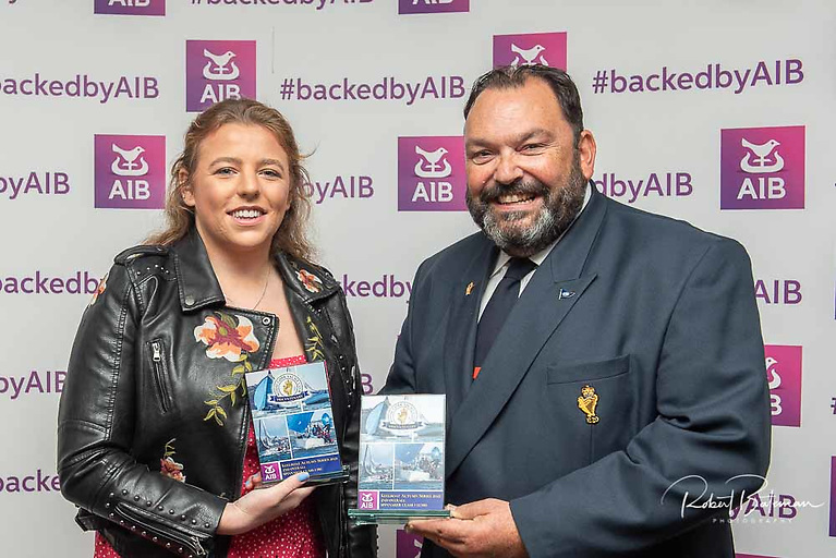 Molly Murphy collects the prize for  Nieulargo (Denis Murphy and Annamarie Fegan) IRC spin 0 winner and second in Club Echo