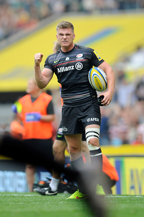 Owen Farrell of Saracens shows how much it means as David Strettle of Saracens' match-winning try is awarded by the TMO during the Premiership Rugby Round 1 match between Saracens and Wasps at Twickenham Stadium on Saturday 6th September 2014 (Photo by Rob Munro)