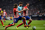 Sergi Roberto Carnicer (c) of FC Barcelona fights for the ball with Filipe Luis (l) and Diego Roberto Godin Leal of Atletico de Madrid during the La Liga 2017-18 match between Atletico de Madrid and FC Barcelona at Wanda Metropolitano  on 14 October 2017 in Madrid, Spain. Photo by Diego Gonzalez / Power Sport Images