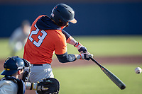 Illinois Fighting Illini shortstop Brandon Comia (23) swings the bat during the NCAA baseball game against the Michigan Wolverines on March 19, 2021 at Fisher Stadium in Ann Arbor, Michigan. Illinois won the game 7-4. (Andrew Woolley/Four Seam Images)