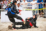 CHE OMAR Siti Zubaidah Che Omar of Malaysia (R) fights against SHAHRUDIN Nurhanishah of Singapore during the Pencak Silat Women's competition on Day Eight of the 5th Asian Beach Games 2016 at Bien Dong Park on 01 October 2016, in Danang, Vietnam. Photo by Marcio Machado / Power Sport Images