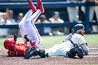 Maryland Terrapins outfielder Troy Schreffler (14) rolls over after scoring against the Michigan Wolverines on May 23, 2021 in NCAA baseball action at Ray Fisher Stadium in Ann Arbor, Michigan. Maryland beat the Wolverines 7-3. (Andrew Woolley/Four Seam Images)