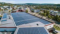 Solar panels on the roof of a large food warehouse for a distributing company in Oslo. Taking advantage of the large space on the roof the company hope to go green and save a substatial amount of electric energy.