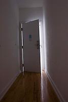 View down hallway with door ajar