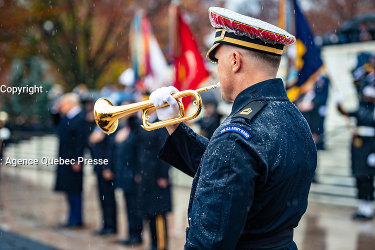 """A bugler from The U.S. Army Band, """"Pershing's Own"""" participates in a Presidential Armed Forces Full Honor Wreath-Laying Ceremony at the Tomb of the Unknown Soldier; Arlington National Cemetery; Arlington, Virginia, November 11, 2020. The wreath was laid by President Donald J. Trump as part of the nation's 67th Veterans Day Observance. (U.S. Army photo by Elizabeth Fraser / Arlington National Cemetery / released)"""