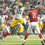 Green Bay Packers safety Charles Woodson pressures quarterback Matt Ryan of the Atlanta Falcons as he throws to wide receiver Brian Finneran during the third quarter of the Divisional round playoff game at the Georgia Dome in Atlanta, Ga., on Saturday, Jan. 15, 2011.