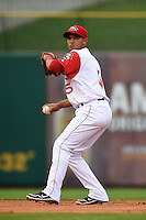 Arkansas Travelers shortstop Maikol Gonzalez (5) throws to first during a game against the San Antonio Missions on May 24, 2014 at Dickey-Stephens Park in Little Rock, Arkansas.  Arkansas defeated San Antonio 4-2.  (Mike Janes/Four Seam Images)