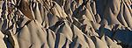 Gracefully eroded canyon walls of soft, porous tufa stone, Cappadocia, Turkey.
