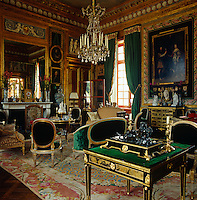 The formal drawing room is filled with an impressive collection of furniture by master craftsmen such as Boulard, Delanois and Sene
