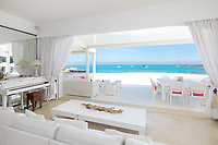 BNPS.co.uk (01202 558833)<br /> Pic: CapVillas/BNPS<br /> <br /> Views of the brilliant blue ocean from the sofa<br />  <br /> A glamorous villa that has hosted a string of celebrities including Winston Churchill, Pablo Picasso, the Duke of Windsor and Edith Piaf is on the market for £9m (10.5m euros).<br /> <br /> The exquisite Villa La Garoupe Beach sits on a natural sand beach and has its own private beach on one of the French Riviera's most exclusive spots.<br /> <br /> It was once a renowned beach club and the list of names connected to the property are endless. French singer Edith Piaf hosted her engagement party to Theo Sarapo there and it was also visited by former US President Harry Truman, writer Ernest Hemingway, Bond actor Sean Connery and movie star Marlene Dietrich.<br /> <br /> The property in Cap d'Antibes has four bedrooms suitable for six to eight people, three bathrooms and a living area overlooking the sea.