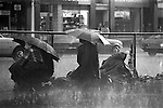 Silver Jubilee Street 1977. UK.  Well wishers wait all night in often pouring rain for the Silver Jubilee royal procession the following morning.