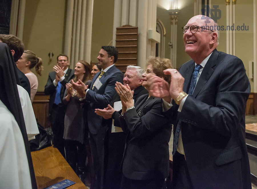 January 20, 2017; Wayne and Diana Murdy applaud at the closing of the Blessing and Organ Recital in the Basilica of the Sacred Heart. (Photo by Barbara Johnston/University of Notre Dame)