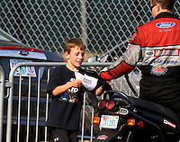 Aug. 2, 2014; Kent, WA, USA; NHRA funny car driver Bob Tasca III with his son during qualifying for the Northwest Nationals at Pacific Raceways. Mandatory Credit: Mark J. Rebilas-