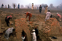 Workers excavate the main drain for the Harappa site. The drain is located at one of the main gates to the city.  4,800 years ago, at the same time as the early civilizations of Mesopotamia and Egypt, great cities arose along the flood plains of the Indus and Saraswati (Ghaggar-Hakra) rivers.  Developments at Harappa have pushed the dates back 200 years for this civilization, proving once and for all, that this civilization was not just an offshoot of Mesopotamia..They were a highly organized and very successful civilization.  They built some of the world's first planned cities, created one of the world's first written languages and thrived in an area twice as large as Egypt or Mesopotamia for 900 years (1500 settlements spread over 280,000 square miles on the subcontinent)..There are three major communities--Harappa, Mohenjo Daro, and Dholavira. The town of Harappa flourished during this period because of it's location at the convergence of several trade routes that spanned a 1040 KM swath from the northern mountains to the coast.