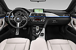 Stock photo of straight dashboard view of 2017 BMW 4-Series 440i-Gran-Coupe 5 Door Hatchback Dashboard