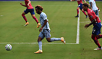 KANSAS CITY, KS - SEPTEMBER 19: Gianluca Busio #27 of Sporting Kansas City sets up a cross as Bryan Reynolds #14 of FC Dallas trails behind during a game between FC Dallas and Sporting Kansas City at Children's Mercy Park on September 19, 2020 in Kansas City, Kansas.