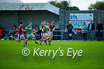 Cromane's Donnchadh Walsh off loads the ball as Cromane build an attack against Castlegregory in the Junior Football Championship Group 2 game