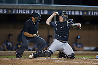 Wilson Tobs catcher Brady Garrison (35) (Marshall University) makes a throw to second base as home plate umpire Brett Stowe looks on during the game against the High Point-Thomasville HiToms at Finch Field on July 17, 2020 in Thomasville, NC. The Tobs defeated the HiToms 2-1. (Brian Westerholt/Four Seam Images)