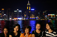 CHINA. Hong Kong. Tourists infront of the Hong Kong skyline. Officially the Hong Kong Special Administrative Region, it is a territory located on China's south coast on the Pearl River Delta. It has a population of 6.9 million people, and is one of the most densely populated areas in the world. 2008