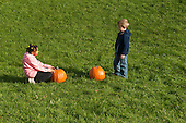 MR / Schenectady, NY. Girl (6, African-American) and boy (6) look at and count two pumpkins. One of a series of photographs where two children count pumpkins from one to five so could be used for a counting spec. MR: Joh18, Lus1. ID: AK-ICP. © Ellen B. Senisi