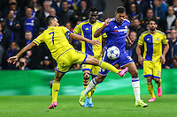 Ruben Loftus-Cheek of Chelsea (left) avoids the challenge from Eran Zahavi of Maccabi Tel-Aviv (left) during the UEFA Champions League match between Chelsea and Maccabi Tel Aviv at Stamford Bridge, London, England on 16 September 2015. Photo by David Horn.