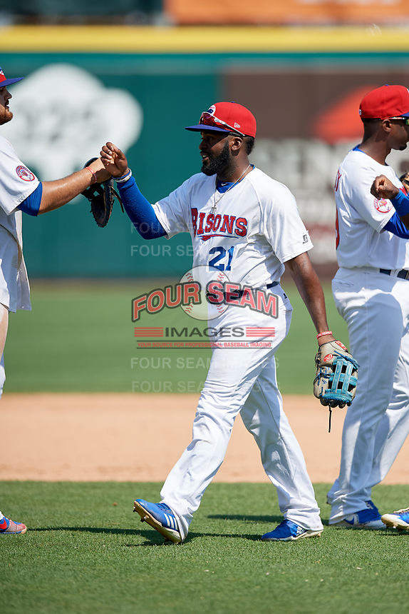 Buffalo Bisons left fielder Dwight Smith Jr. (21) high fives with teammates after a game against the Pawtucket Red Sox on June 28, 2018 at Coca-Cola Field in Buffalo, New York.  Buffalo defeated Pawtucket 8-1.  (Mike Janes/Four Seam Images)