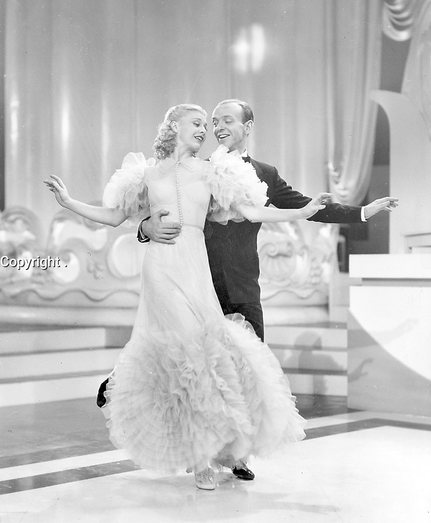 """Swing Time"""" (1936), one of the silver screen's most amusing and romantic musicals, will be presented as part of the Academy of Motion Picture Arts and Sciences' George Stevens Lecture on Directing series at on Tuesday, October 26, at 7:30 p.m. at the Samuel Goldwyn Theater.<br /> <br /> Pictured: Ginger Rogers and Fred Astaire in a scene from SWING TIME, 1936."""