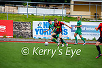 A tussle for possession between Alex Hinnigan of Kerry and Brandon Kelly of Carlow Kilkenny in the U17 League of Ireland