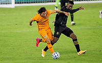 CARSON, CA - OCTOBER 28: Matias Vera #22 of the Houston Dynamo battles with Jose Cifuentes #11 of the Los Angeles FC during a game between Houston Dynamo and Los Angeles FC at Banc of California Stadium on October 28, 2020 in Carson, California.
