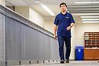 October 12, 2021; Tengfei Luo, Professor of Aerospace and Mechanical Engineering, walks to his office. (Photo by Matt Cashore/University of Notre Dame)