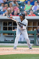 Michael Martinez (7) of the Columbus Clippers squares to bunt against the Charlotte Knights at BB&T BallPark on May 27, 2015 in Charlotte, North Carolina.  The Clippers defeated the Knights 9-3.  (Brian Westerholt/Four Seam Images)