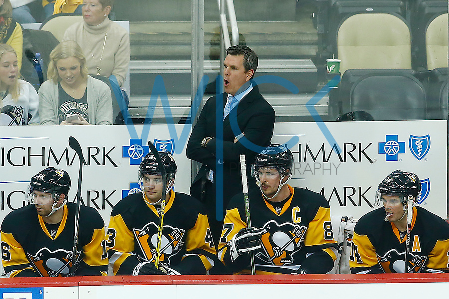 Head coach Mike Sullivan yells from the bench against the New York Rangers during game one of the first round of the Stanley Cup Playoffs at Consol Energy Center in Pittsburgh, Pennsylvania on April 13, 2016. (Photo by Jared Wickerham / DKPS)